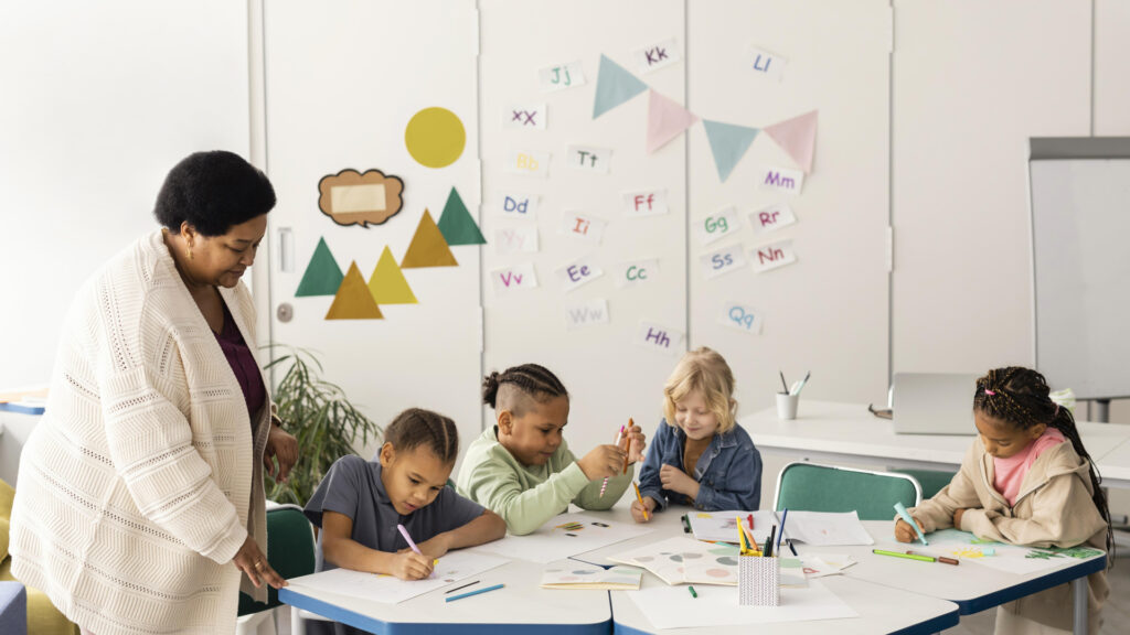 a classroom with kids and a teacher and decorations on the wall